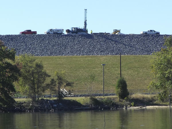 A dam holding back a coal ash pond sits beside the Catawba River, in Gaston County.