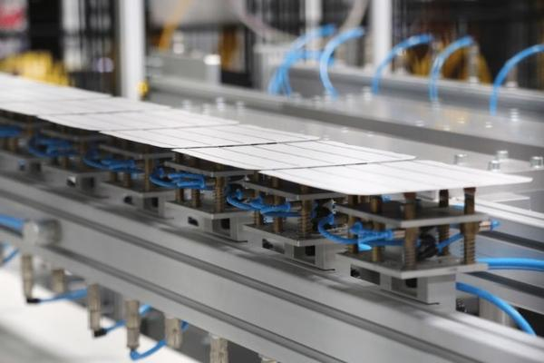 <p>Solar cells are built into panels at the SolarWorld Americas plant.</p>
