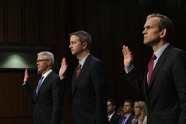 (L-R) Vice President and General Counsel for Facebook Colin Stretch, General Counsel for Twitter Sean Edgett, and Senior Vice President and General Counsel for Google Kent Walker are sworn in during a hearing before the Senate (Select) Intelligence Committee  on November 1.