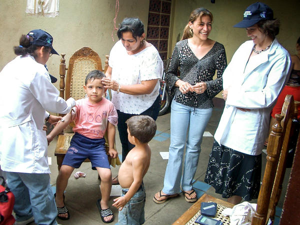 Researchers draw blood from a boy enrolled in the dengue study at a clinic in Managua, Nicaragua.