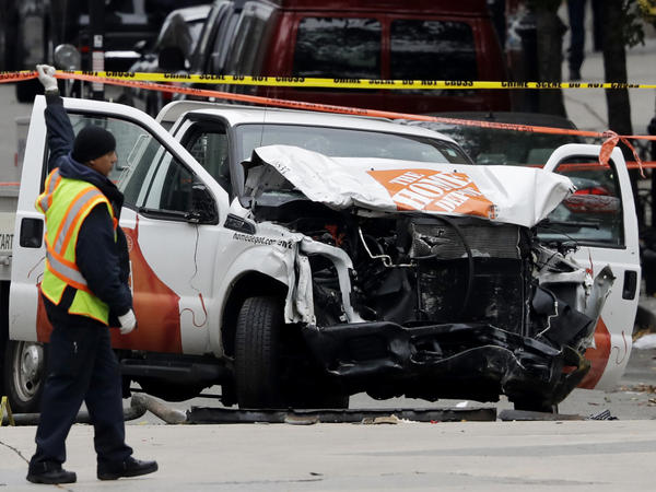 On Wednesday, a damaged Home Depot truck remains at the scene of a deadly attack in New York City the day before.
