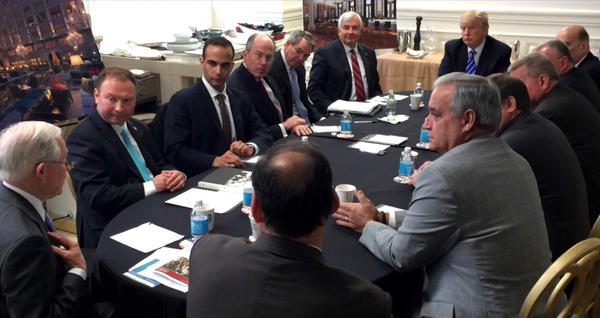"A photo posted in March, 2016 on President Donald Trump's Twitter account shows George Papadopoulos, third from left, at a national security meeting with then-candidate Donald Trump. The President told reporters on Friday morning that ""I don't remember much"" about the controversial meeting."