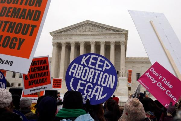 <p>Pro-abortion rights signs are seen in front of the U.S. Supreme Court, Friday, Jan. 22, 2016.</p>