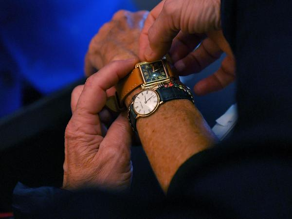 A customer tries watches at a watchmaker shop on Oct. 26, in Nantes, western France, two days before the end of Daylight Saving Time.