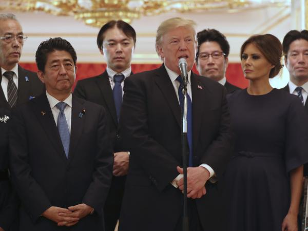 President Trump, standing with his wife, Melania, and Japanese Prime Minister Shinzo Abe, speaks Monday in Tokyo at a meeting with the families of Japanese citizens abducted by North Korea. At center rear is Koichiro Iizuka, whose mother, Yaeko Taguchi, was abducted by North Korean agents in 1978.