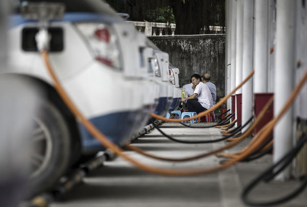 A row of BYD electric taxis are charged up at the company's charging station in Shenzhen.