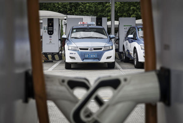 A BYD electric taxi is charged at the company's charging station in Shenzhen, China.