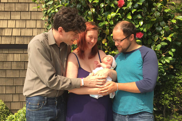 David Jay (left), Avary Kent (center) and Zeke Hausfather with baby Octavia. (Courtesy David Jay)