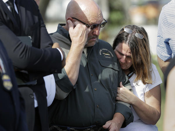 Pastor Frank Pomeroy and his wife Sherri near the First Baptist Church on Monday in Sutherland Springs, Texas. A gunman opened fire inside the church on Sunday, killing at least 26 people, including the Pomeroys' daughter, Annabelle.