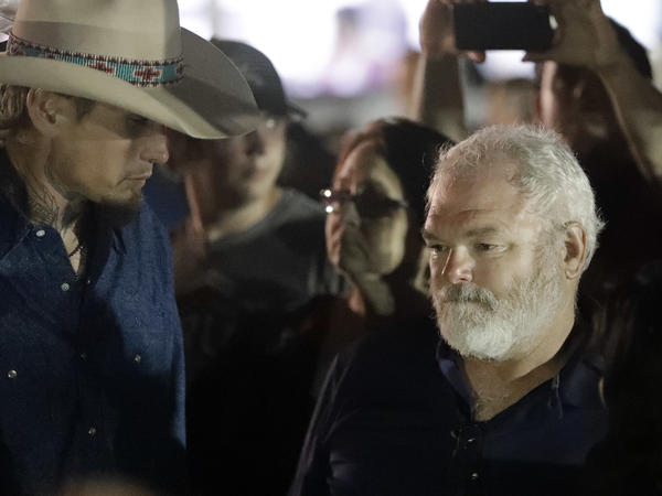 The men who chased down the Texas shooter — Stephen Willeford (right) and Johnnie Langendorff — attend Monday's vigil for the victims of the First Baptist Church shooting in Sutherland Springs, Texas.