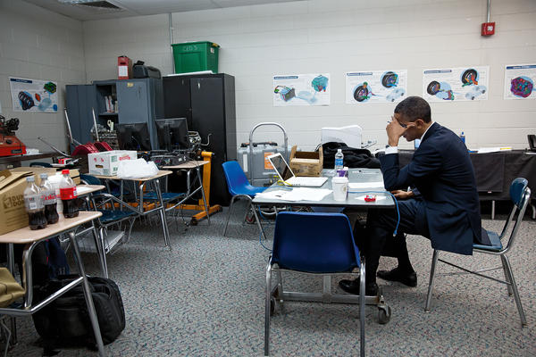 <em></em>Obama sits alone in a classroom on Dec. 16, 2012, before speaking at the memorial service for victims of the Sandy Hook Elementary School shooting<em>.</em>