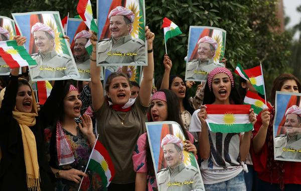 Iraqi Kurdish students hold posters of Iraqi Kurdish leader Masoud Barzani during a demonstration in his support in Irbil, Iraqi Kurdistan, on Oct. 30.