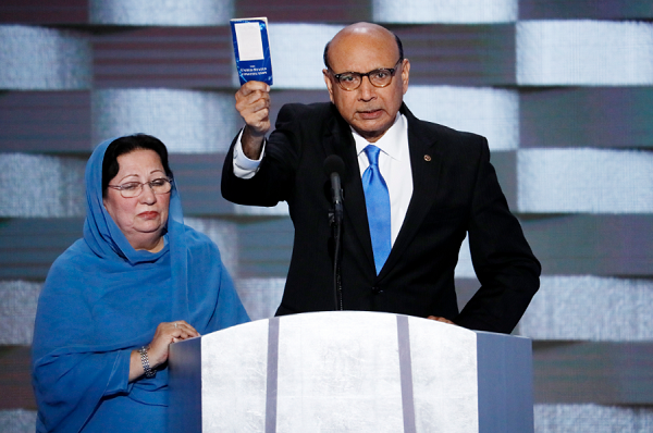 Khizr Khan, father of fallen US Army Capt. Humayun S. M. Khan speaks as his wife Ghazala listens during the final day of the Democratic National Convention in Philadelphia , Thursday, July 28, 2016.