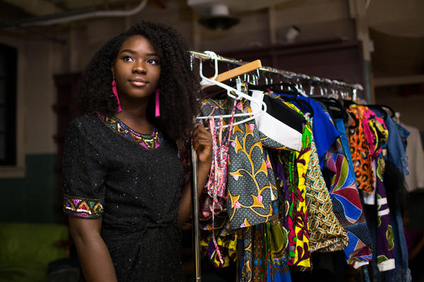 Oluwatoyosi, a chemical engineering major at UT-Austin, prepares to show her collection of ankara clothing at Fest Africa: Africa Uncut.