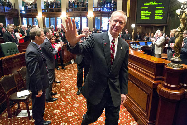 Gov. Bruce Rauner walks through the Illinois House before his annual budget address in this file photo from earlier this year.