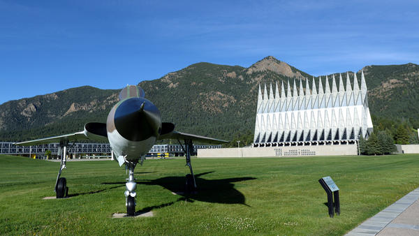The U.S. Air Force Academy has completed its investigation into an incident of racist graffiti on campus. The school's terrazzo and chapel are seen here in Colorado Springs, Colo., this summer.