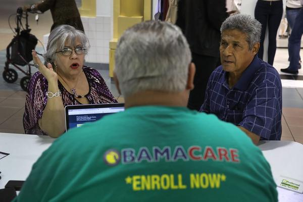 Isabel Diaz Tinoco (left) and Jose Luis Tinoco speak with Otto Hernandez, an insurance agent from Sunshine Life and Health Advisors, as they shop for insurance under the Affordable Care Act at a store setup in the Mall of Americas on Nov. 1, 2017 in Miami, Fla. The open enrollment period to sign up for a health plan under the Affordable Care Act runs until Dec. 15. (Joe Raedle/Getty Images)