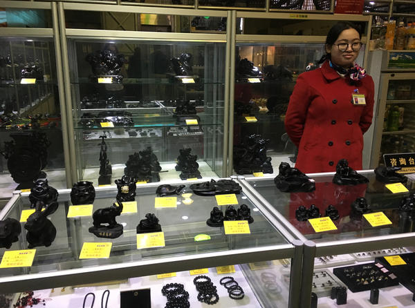 Statues made from material mined alongside coal are on sale in China's national coal museum gift shop.