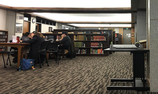 Students study inside Amherst College's Frost Library. (Max Larkin/WBUR)