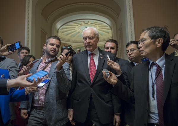 Senate Finance Committee Chairman Orrin Hatch, R-Utah, surrounded by reporters in the U.S. Capitol. The committee will hold its hearing on its tax bill next week. Senators aim  to pass it out of committee before the Thanksgiving holiday.