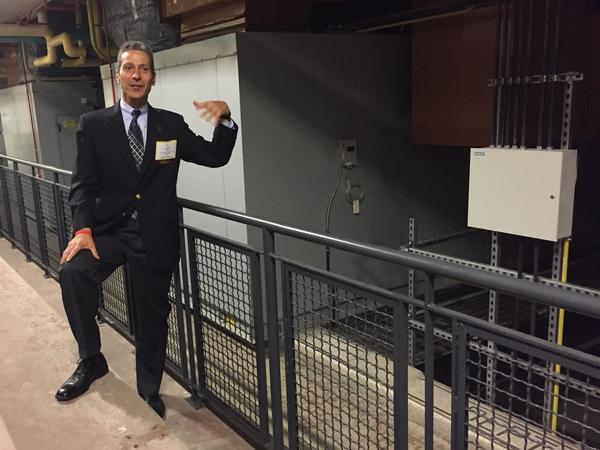 Gregory Reed tours a former school now becoming a lab for energy research in Pittsburgh. Reed says he's focusing on how microgrids can provide reliable, resilient and locally produced energy.