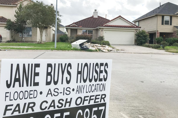 Lawn signs advertising real estate investors interested in buying flooded homes have popped up in flooded neighborhoods around the Houston area.