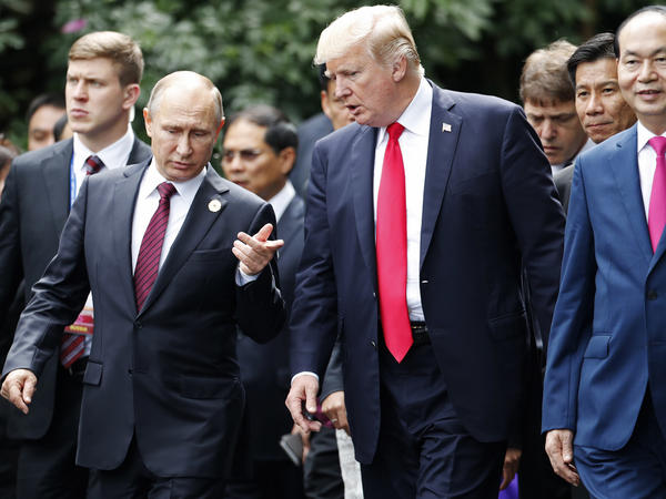 """A day after meeting with the Russian president during an economic summit in Vietnam, President Trump told reporters he sided with U.S. intelligence agencies but believed that Putin """"feels"""" his country """"did not meddle in the election."""""""
