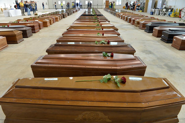 Some 300 people died off the island of Lampedusa in a shipwreck southern Italy in 2013. Here, their coffins fill a large room as they wait to be moved.