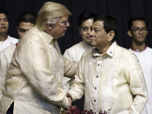 President Trump shakes hand with Philippines President Rodrigo Duterte during the gala dinner marking ASEAN's 50th anniversary in Manila, Philippines, on Sunday.