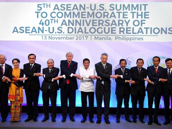 Asian leaders and President Trump pose for a photo during the Association of Southeast Asian Nations Summit in Manila on Monday.