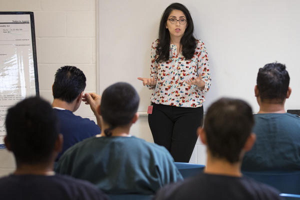 Virginia Cole, with the Northwest Immigrant Rights Project, teaches a legal aid class at the Northwest Detention Center on Wednesday, June 21, 2017, in Tacoma, Wash. (Megan Farmer/KUOW)
