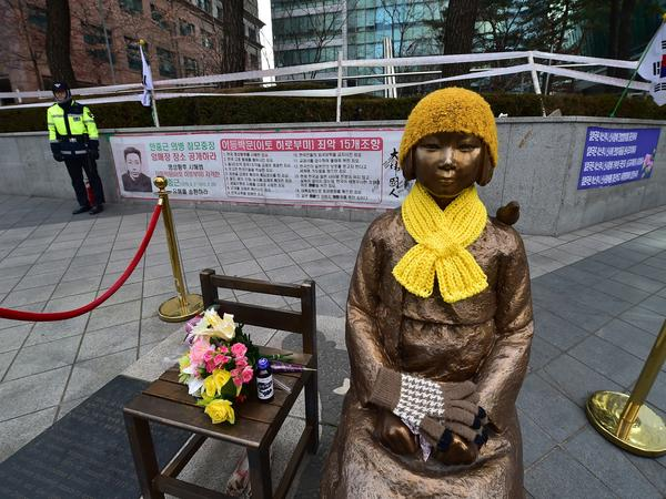 "A statue of a teenage girl — the original monument to former ""comfort women"" who served as sex slaves for Japanese soldiers during World War II — sits in front of the Japanese Embassy in Seoul."