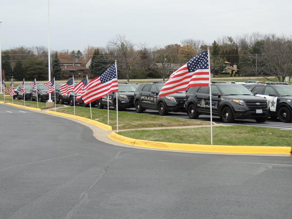 "Police vehicles are staged and ready for the ""last tour"" procession that followed the funeral for Officer Jaimie Cox."