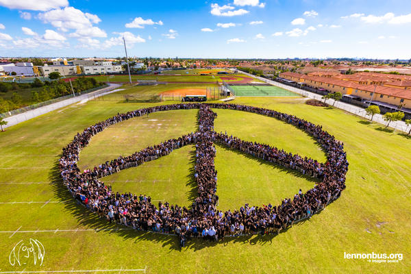 Three thousand Hialeah Gardens High School students and staff gather in the shape of a peace sign.
