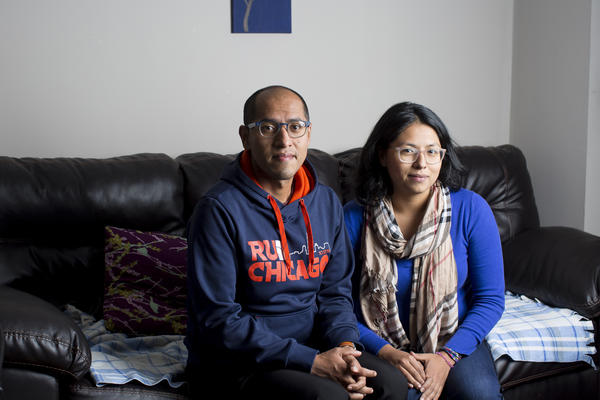 Cristian Mendoza and Laura Mendoza pictured in the home they bought for their parents in Humboldt Park on Nov. 6, 2017, in Chicago. (Michelle Kanaar for Here & Now)