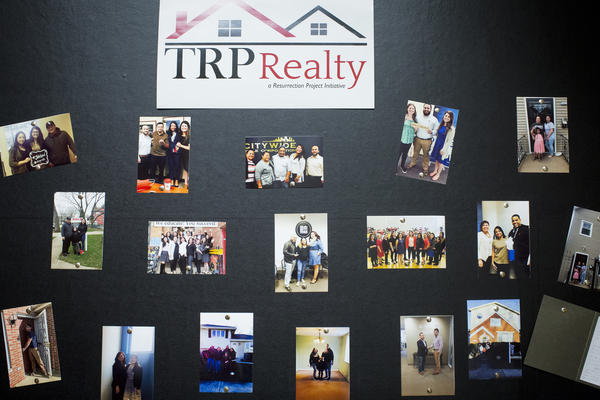 Photos of people closing on homes with TRP Realty, the Resurrection Project's in-house realty group, as part of the Full Circle Homes Initiative, pictured on Nov. 6, 2017, in Chicago. (Michelle Kanaar for Here & Now)
