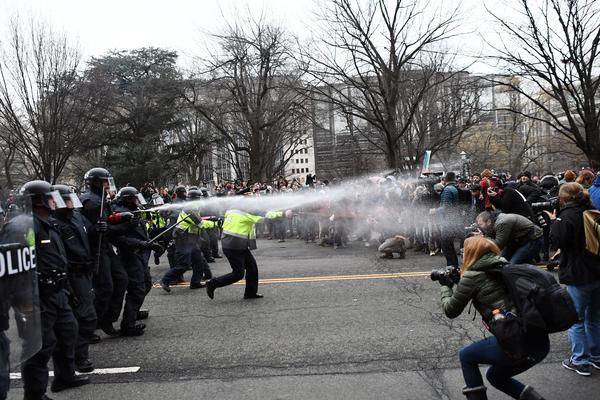 Police and protesters face off on Jan. 20 in Washington, D.C., during President Trump's inauguration. More than 200 people were arrested and charged with rioting. Jury selection began Wednesday, and opening statements in the first trials are set to begin next week.