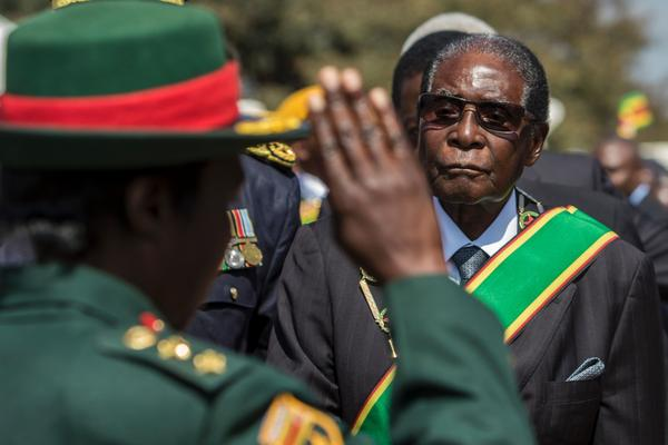 Zimbabwe's President Robert Mugabe inspects a guard of honor during official Heroes Day commemorations on Aug. 14, 2017.