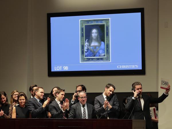 Bidding representatives react after <em>Salvator Mundi</em> sold for $450 million at Christie's on Wednesday.