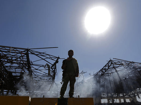 A Houthi fighter inspects the site of an airstrike in the Yemeni capital, Sanaa, earlier this month.