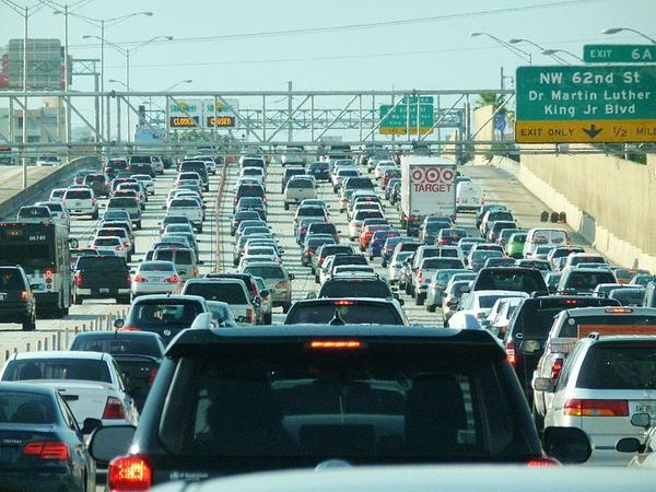 Motorists make their way through rush hour on I-95 in Miami.