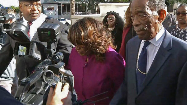 Former U.S. Rep. Corrine Brown enters the federal courthouse in downtown Jacksonville.