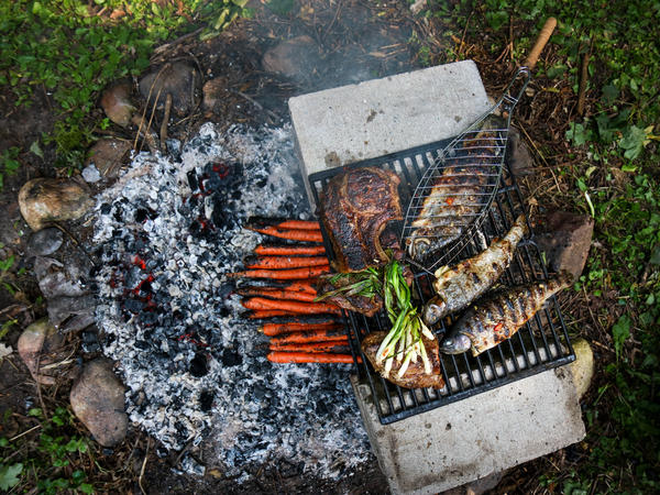 Rainbow trout on a grill. Yia Vang says that food played a central role in his home — his mother grew vegetables and his father cooked meat over a fire pit in the backyard.