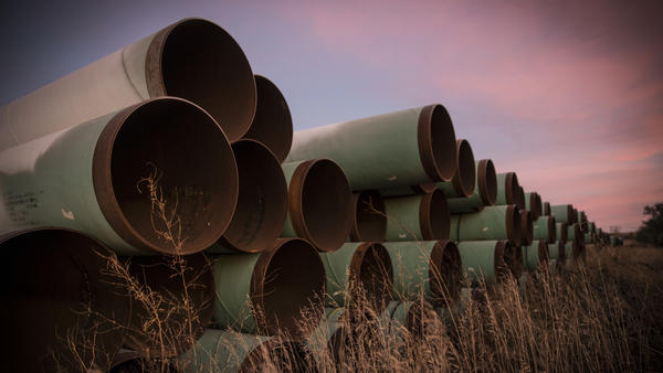 Miles of unused pipe, prepared for the proposed Keystone XL pipeline, sit in a lot outside Gascoyne, N.D., in 2014.