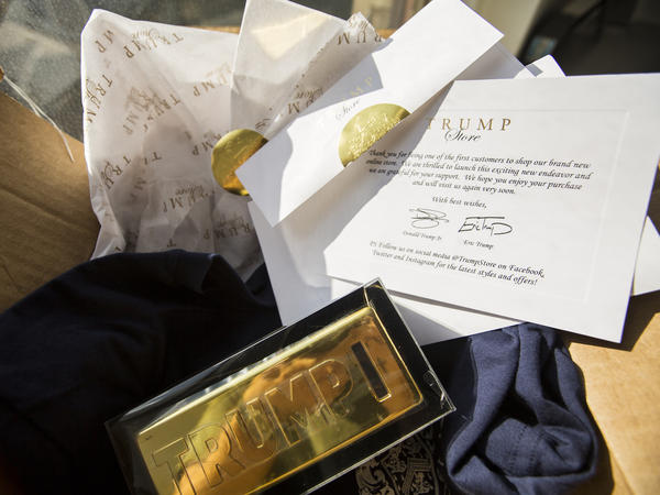 """A $25 Trump """"gold coin bar bank"""" purchased from TrumpStore.com comes with a thank you card signed by Donald Trump's sons, Donald Trump Jr. and Eric Trump."""