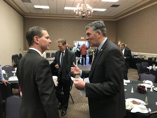 U.S. Rep. Darin LaHood, right, chats with Judge Bill Yoder following a Republican Party breakfast in Bloomington on Monday, Nov. 20, 2017.