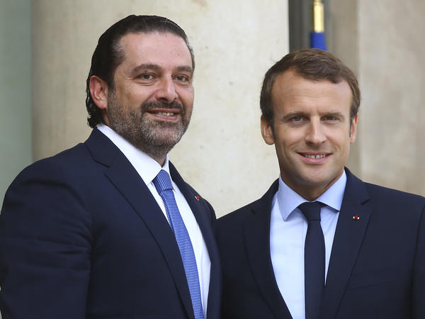 France's President Emmanuel Macron, right, welcomes Lebanon Prime Minister Saad Hariri, prior to a Paris meeting in September.