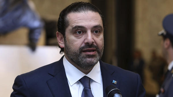 In this photo from Lebanon's government, Lebanese Prime Minister Saad Hariri reads a statement after his meeting with Lebanon's president, Michel Aoun, in Baabda, Lebanon, on Wednesday.