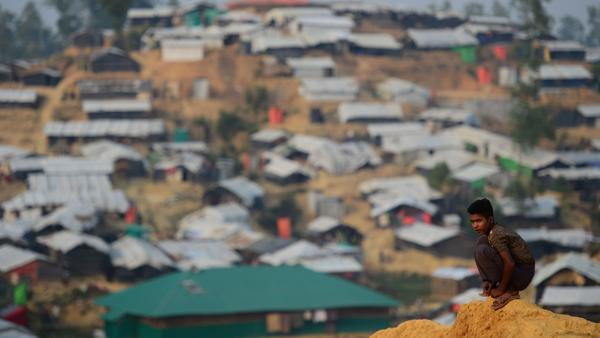A Rohingya refugee boy looks on at Balukhali refugee camp in the Bangladeshi district of Ukhia on Wednesday. An estimated 618,000 Muslim Rohingya have fled mainly Buddhist Myanmar since a military crackdown was launched in Rakhine in August. Refugees describe a campaign of rape, murder and arson.