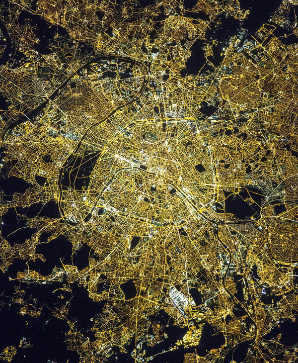 "Paris, often referred to as the ""City of Light"", as photographed by astronauts aboard the International Space Station."